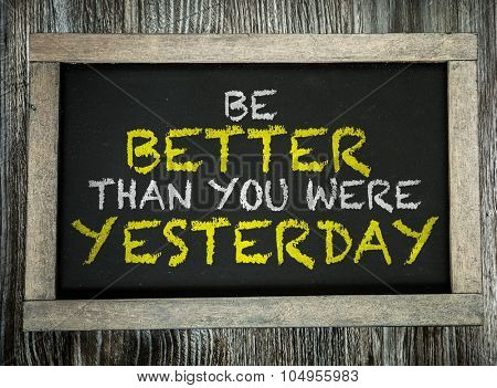 Be Better Than You Were Yesterday written on chalkboard poster