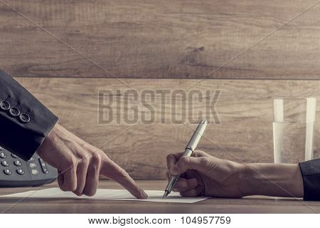 Employer Showing His Employee Where To Sign A Contract
