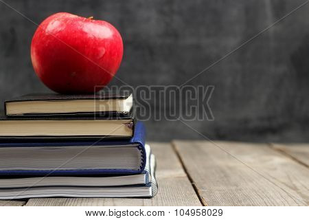 Notebook Stack With Apple And Chalkboard