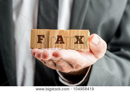 Businessman Hand Holding Three Wooden Cubes Reading Fax
