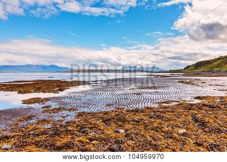 Iceland in the summer. The picturesque bay of Hoonah during low tide at sunset