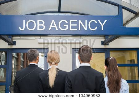 Businesspeople Standing Outside Job Agency