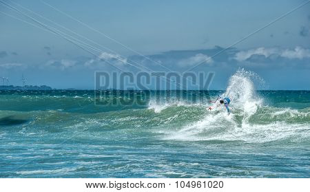 Extreme sports photography of athlete on kiteboard surfing in sea