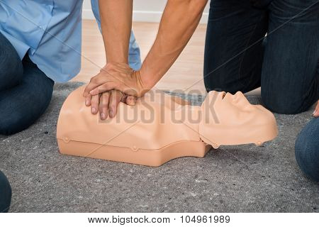 Person Practicing Cpr Chest Compression