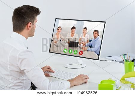 Businessman Videoconferencing With Colleagues