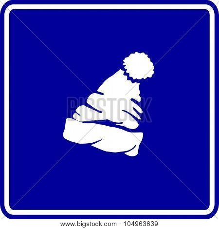 cuff beanie with pom pom sign