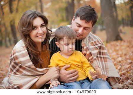 Family in the autumn park