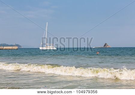 Beautiful Exotic Coast And Luxury Sail Boat Close To The Shore