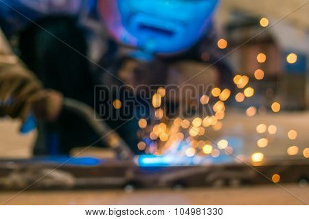 Heavy Industry Welder Worker In Protective Mask Hand Holding Arc Welding Torch Working On Metal Cons