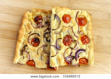 Focaccia With Onion And Tomato - Two Slices On Center