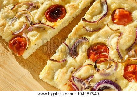 Focaccia With Onion And Tomato - Closeup