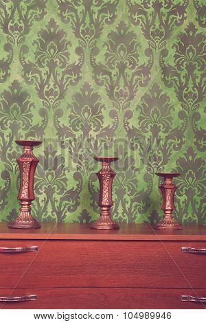 Three Vintage Chandeliers On Green Rococo Style Pattern Background