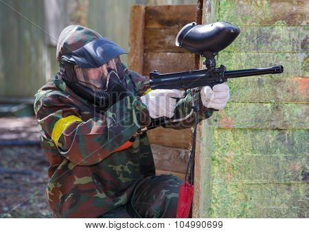 Paintball Player Aiming Outdoors