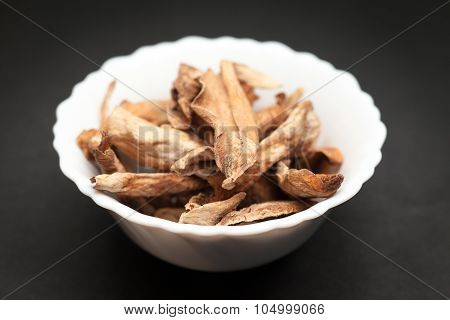 Organic Sour dried mango in white bowl.