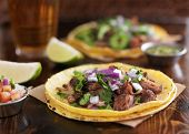 authentic mexican street tacos with barbacoa beef on yellow corn tortilla poster