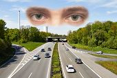 Eyes are seeing on a motorway junction on a sunny day. poster