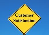 customer satisfaction posted on a yellow sign poster