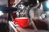 Automatic espresso machine pouring coffee in cups at restaurant or pub. Barista concept with machinery tamper coffee and tools poster