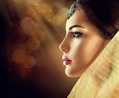 Beautiful fashion Indian woman profile portrait with oriental accessories. Indian girl with beauty jewels. Hindu model with perfect make-up. India poster