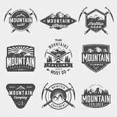 vector set of mountain exploration vintage logos emblems silhouettes and design elements. logotype templates and badges with mountains forest trees tent ice axe. outdoor activity symbols poster