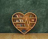 Concept of training. Wooden bookshelf full of book in form of heart on the blackboard background. Science about human. Medicine. A human have more knowledge about health. poster