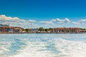 The seaside town of Grado (province of Gorizia) seen from the lagoon on a sunny summer day. Friuli Venezia Giulia Italy. poster