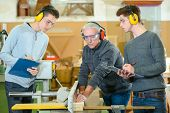 Male students in a woodwork class poster