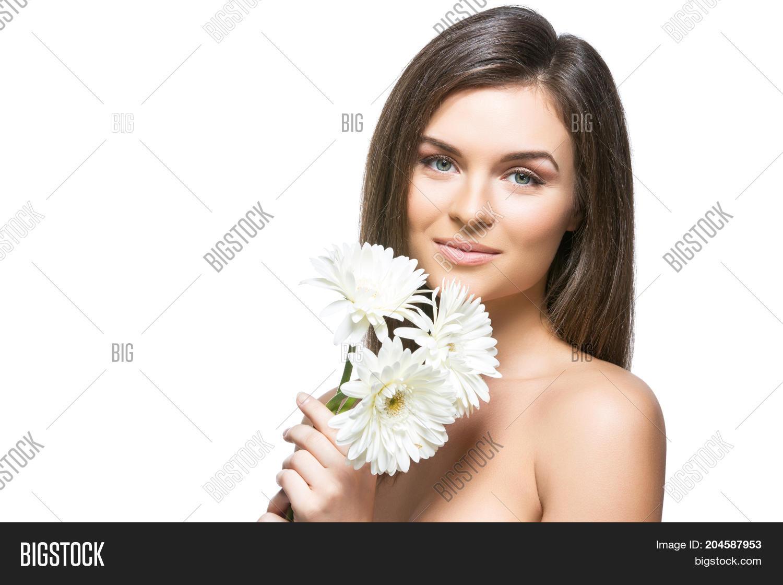 Beautiful young woman natural image photo bigstock beautiful young woman with natural makeup and straight hair holding white herberas flowers beauty shot izmirmasajfo