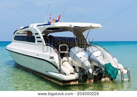 Beautiful Beach With Motor Speed Boat