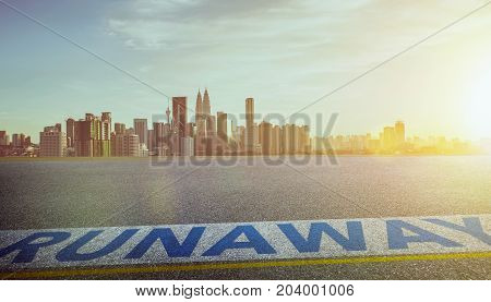 View of the empty asphalt road with runaway word and city skyline background . Evening scene .