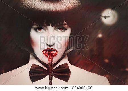 Sexy hungry dominant vampire bite bloody whip at night