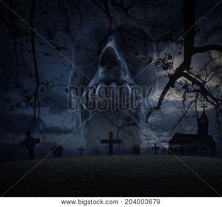 Human skull scream grass dead tree cross birds with church over spooky cloudy sky Halloween concept