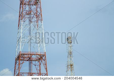 Two signal tower with blue sky background.