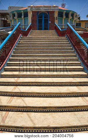 March 19 2017 Tumbes Peru: stairs of a street overpass in the center of the tropical town