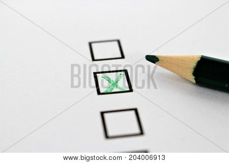 An concept Image of a green pencil and a questionnaire