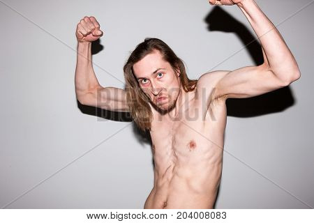 Aggressive gangster male showing off his muscles. Self-satisfied man, sports guy bragging about courage, power concept