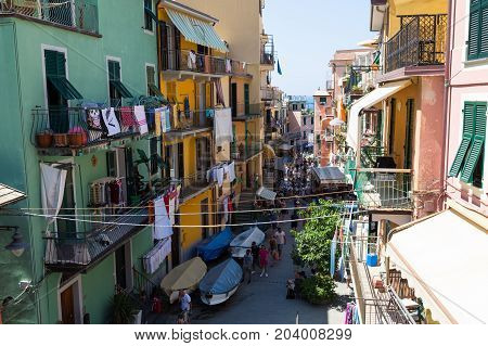 07. 08.2017 - small town MANAROLA Italy . Famous National Park Cinque Terre Liguria Region Northern Italy. Ancient street leading to the sea filled with tourists. Hot summer of 2017 beach season. World Heritage Site UNESCO. Tourist sight. Top view