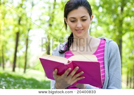Girl Reading Book In Nature