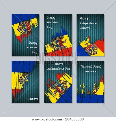 Moldova Patriotic Cards For National Day. Expressive Brush Stroke In National Flag Colors On Dark St