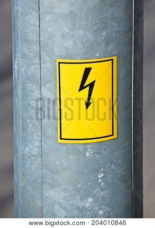 Part of an electricity pylon with danger sign