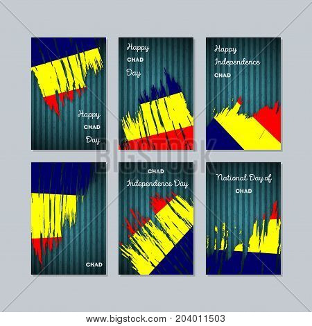 Chad Patriotic Cards For National Day. Expressive Brush Stroke In National Flag Colors On Dark Strip