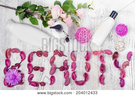 Beauty cream lotion flowers on a white wooden background isolation