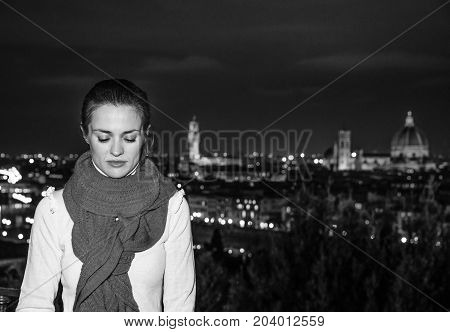 Pensive Young Woman In Front Of Panoramic View Of Florence