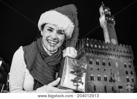 Tourist Woman Against Palazzo Vecchio Showing Christmas Gift