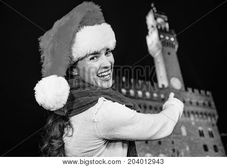 Smiling Woman In Christmas Hat Pointing On Palazzo Vecchio