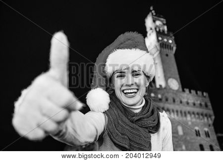 Woman In Christmas Hat Near Palazzo Vecchio Showing Thumbs Up
