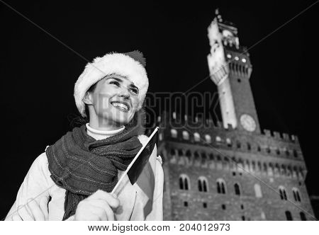 Woman In Christmas Hat With Italian Flag Looking Into Distance