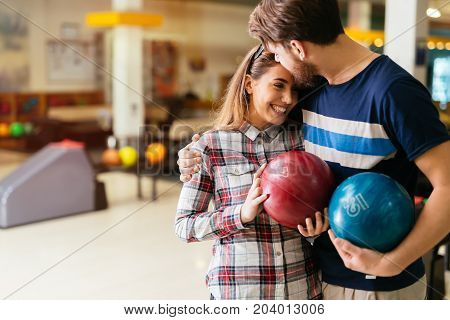 Beautiful couple in love dating and bowling