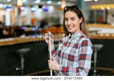Happy beautiful woman playing snooker at club