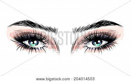 Beautiful blue eyes with big lashes and fashionable makeup